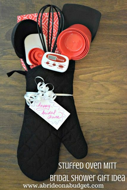 #ad Looking for a really useful and unique bridal shower gift idea? Check out this Stuffed Oven Mitt Bridal Shower Gift Idea from www.abrideonabudget.com. It's made solely from items at Dollar Tree.