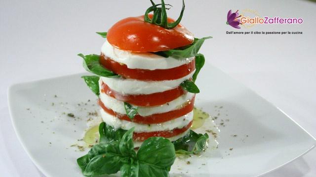 Tasty caprese (Fresh tomatoes and mozzarella) with oregano sauce
