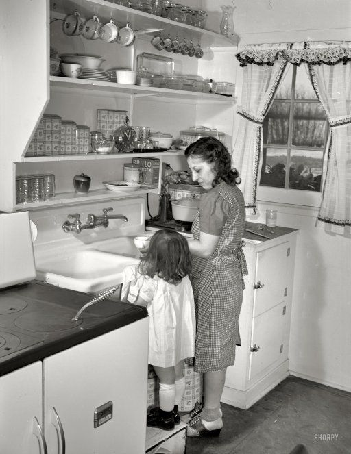 Little Ann Heath Pushes Her Footstool To The Sink Help Mother Clean Up Dinner Dishes In Pas New Four Room Defense Housing Unit Located