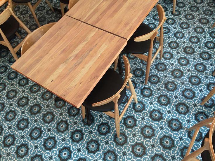 Kuzina cafe restaurant. traditional spanish tiles. ash wegner chair