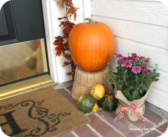 Fall Front Door Decor- wrap existing pots in burlap and finish with ribbon for instant fall look.