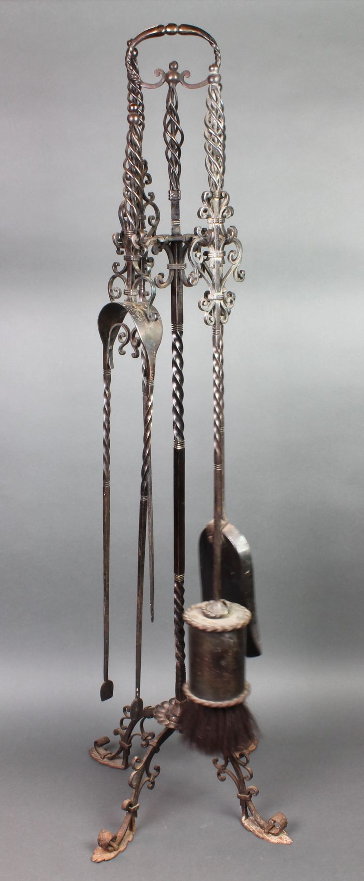Lot 189, A wrought iron 4 piece fireside companion set comprising shovel, poker and tongs, sold for  £100