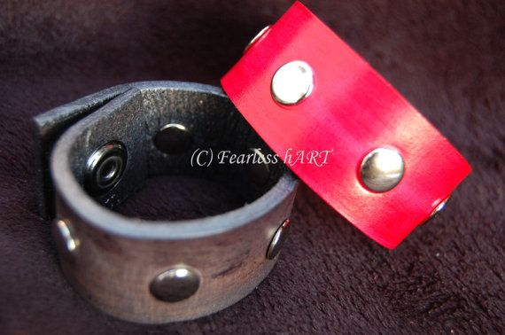 Made to Order leather cuffs with rivets.  Available in a variety of colors.
