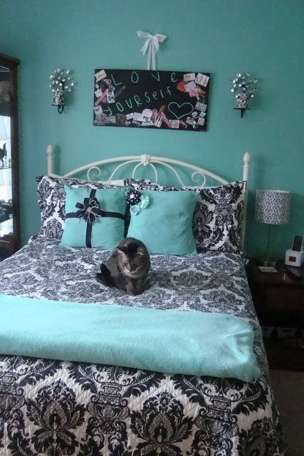 Gorgeous turquoise black and white room