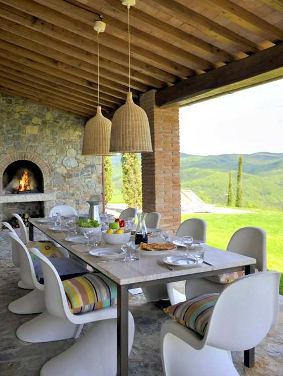Fradiani surrounds the travertine-topped table (that he designed himself) with Vernor Panton chairs.
