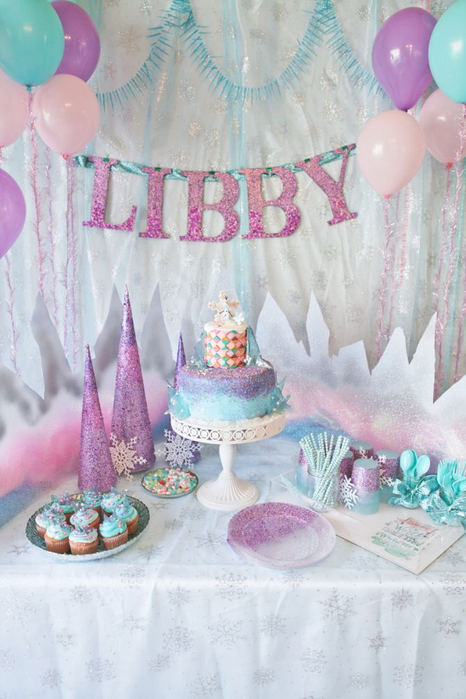 Pull out the stops with this amazing Frozen themed birthday party for your Anna, Elsa and Olaf fan - decked out in purple, pink, blue and glitter. #inspiration