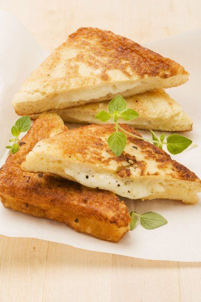 MOZZARELLA IN CARROZZA (Lazio and Campania) is a tasty appetizer, consisting of fried slices of bread with mozzarella inside #food #italy
