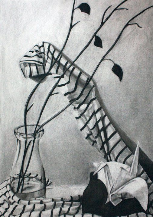 Still Life charcoal by Jenny Hopson. I like this drawing because of the reflections of the glass and how the cloth is positioned. The way it's arranged makes it more interesting and there's more that you notice the longer you look at it.