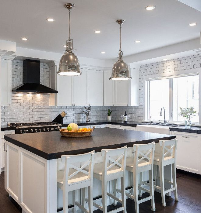 Thick Quartz Countertop and white crackle subway tile.  Like the island and black range hood