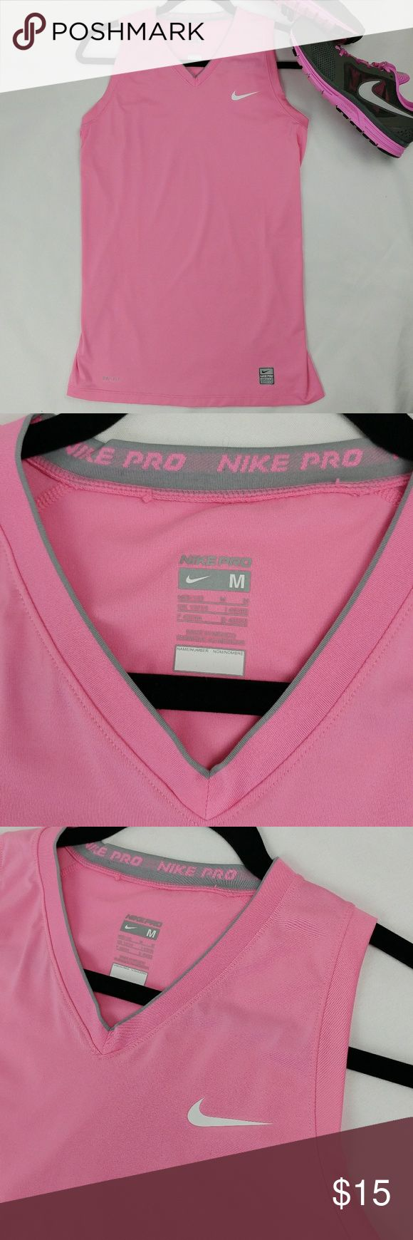 "Nike Pro workout tanktop womens Nike Pro womens workout tanktop Size M (8-10) In great condition. Tiny hole on the back of the collar from where the tag used to be. Armpit to armpit measuring laying flat across 17"" Length 28"" 84% polyester 16% spandex Nike Tops Tank Tops"