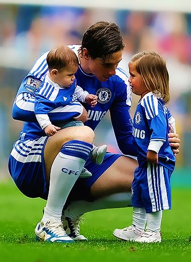 Spanish Soccer player Fernando Torres and his children Nora and Leo