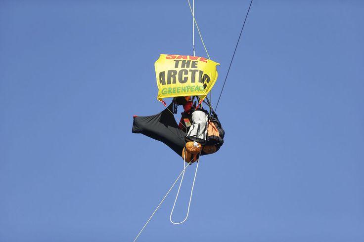 Greenpeace activists hang off the St Johns Bridge