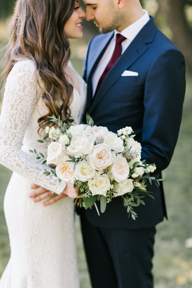 Calgary, Alberta bride and groom portraits with bridal bouquet full of white garden roses, white snowberries and mixed eucalyptus. Photo: Heart and Sparrow Photography- Calgary, Alberta Bouquet: Flowers by Janie