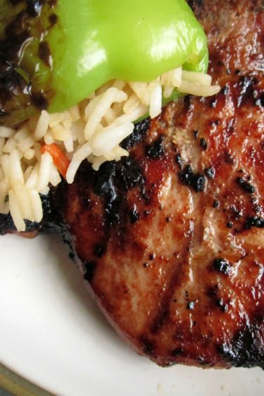 Asian Pork Chops with Stuffed Peppers 4 5-ounce bone in pork loin chops, trimmed 2 tablespoons soy sauce 1 tablespoon brown sugar 2 teaspoons grated, peeled fresh ginger 1 grated large garlic clove 1 teaspoon Asian sesame oil 1 teaspoon sesame seeds, toasted 1/2 teaspoon 5-Spice power