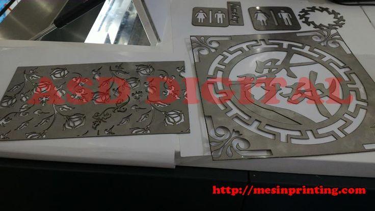 Mesin laser cutting metal