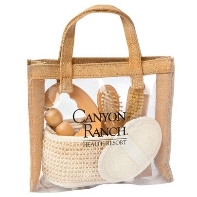 A nice natural material of jute, featuring clear front and back panels to see through. This promotional and private label spa gift set features 5 gift items: wooden massage pad, sisal sponge, wooden body brush, wooden hair brush, and sisal back scrubber.