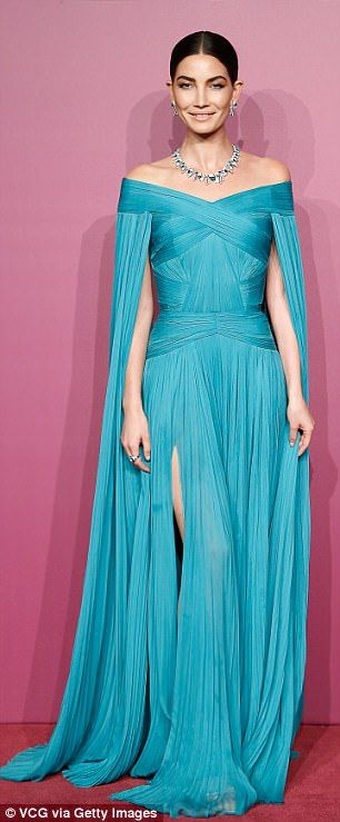 Fancy:The 32-year-old model wowed in her exquisite aqua J. Mendel gown with caped sleeves and a ruched texture, adding Bulgari jewelry