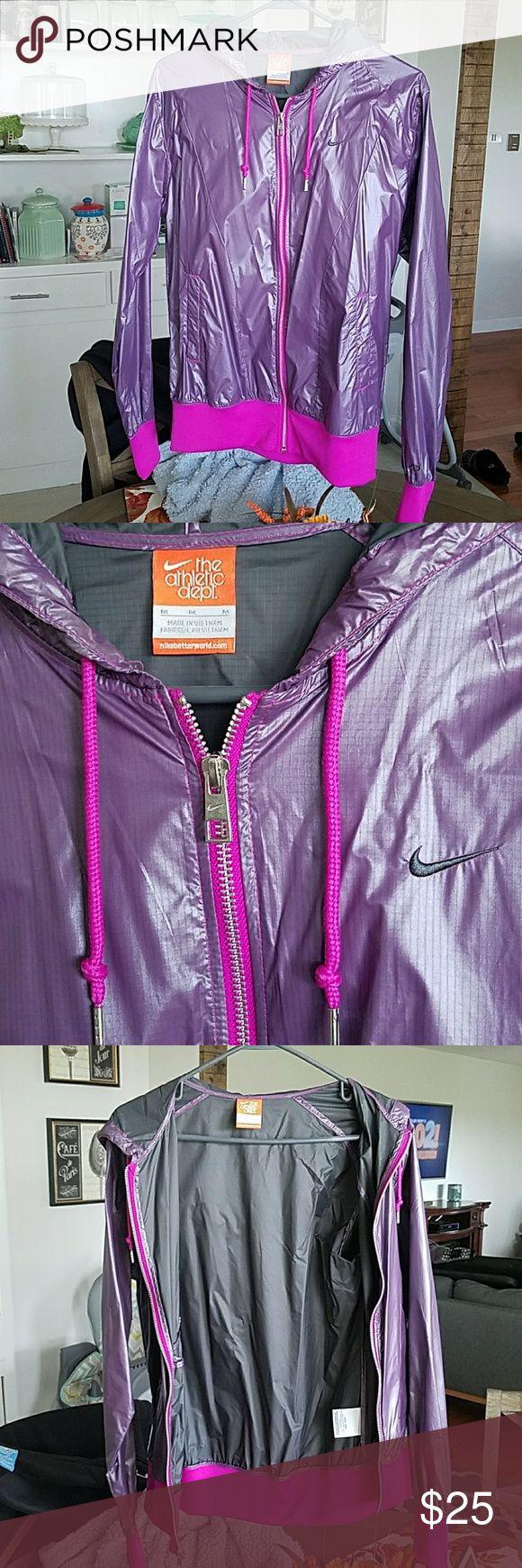 Nike rainjacket NWOT Purple Nike Rain Jacket, never been worn, pink elastic waistband and wristbands, size M, super lightweight nylon. Nike Jackets & Coats