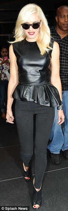 Gwen, vamped it up in a sleeveless leather top with asymmetrical peplum waistline and skinny trousers