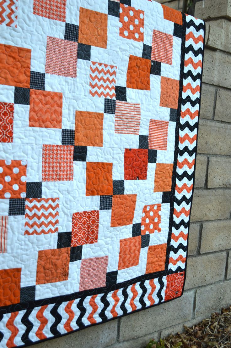 Halloween Disappearing 9-Patch Quilt tutorial by Jedi Craft Girl. Featuring black & orange wave fabric from Riley Blake Designs
