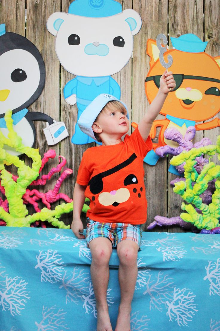 My amazing seemstress mother in law made the boys shirts for the party. They could not be cuter. I ordered the hats on oriental trading and simply stuck an octonauts logo sticker on the front. The characters are all done on cheap poster board and pieced together. I used an opaque projector to speed up that process because he had to have the whole crew..