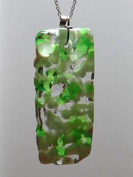 Melt crushed (or whole) pony beads in foil, then drill a hole in the top to make a pendant for a necklace or key chain.