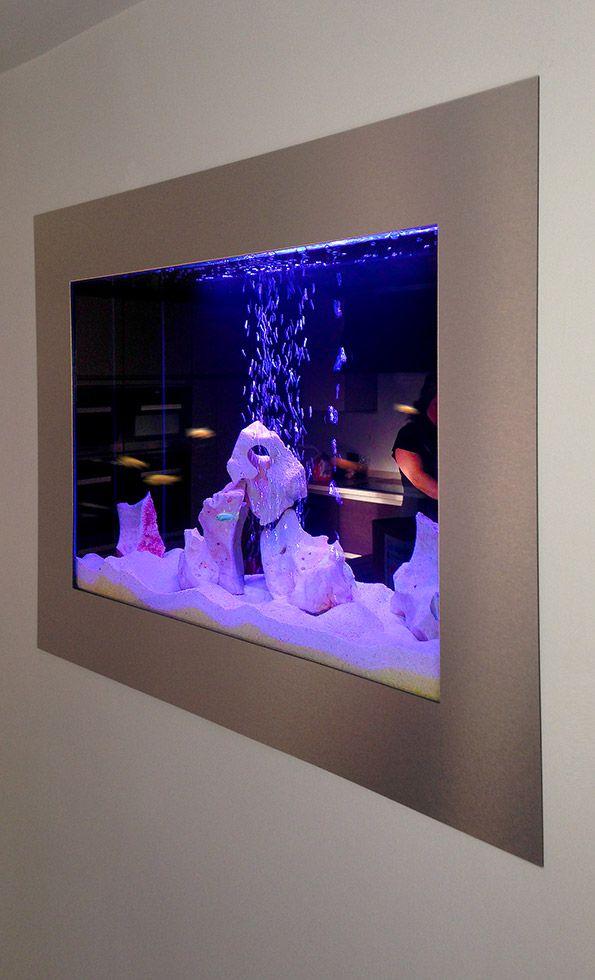 #aquarium custom built through the wall