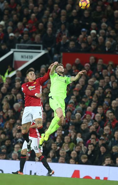 Marcos Rojo of Manchester United in action with Adam Lallana of Liverpool during the Premier League match between Manchester United and Liverpool at...