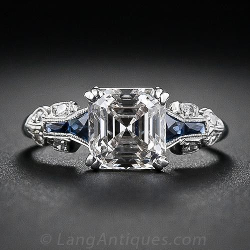 1.75 Carat  Asscher-Cut Diamond Art Deco Ring A glorious and glistening classic square emerald-cut - aka Asscher-cut - diamond engagement ring, crafted in platinum and accented with calibre-cut faceted sapphires - circa 1930s. Rare and original Art Deco engagement ring.