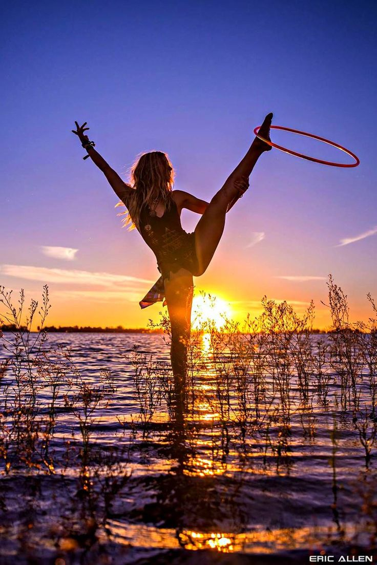 Courtney G's Stunning Sunset Hoop Pose at Symbiosis. Courtney strikes a stunning pose while hooping it up at Symbiosis. Photo by Eric Allen Photography.