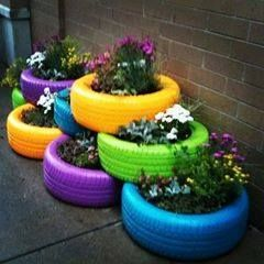 Reuse tires and paint them with bright colors and make a stacked planter garden out of them!
