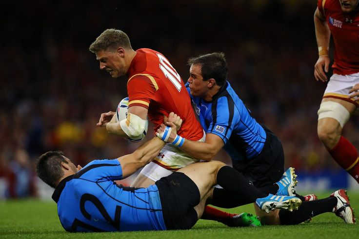 Rugby World Cup 2015 - Match Centre - Match 7 - Sept.20 2015 - Rhys Priestland Wales 54 v Uruguay 9 -  Rugby World Cup 2015 RHYS BROUGHT TO HIS KNEES: Uruguay's Andres Vilaseca (l) drags Wales' Rhys Priestland on to his knees to prevent a breakaway