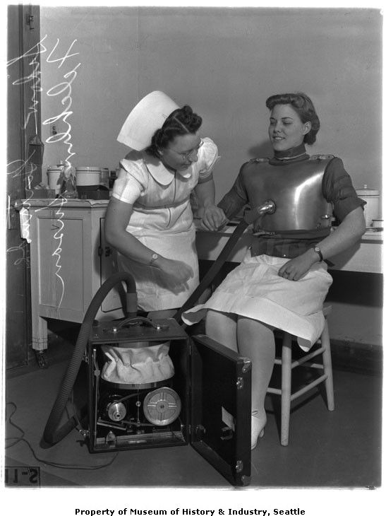 Nurses Gertrude Sidow  Susan Felchlin trying out a portable iron lung, Seattle, 1940.