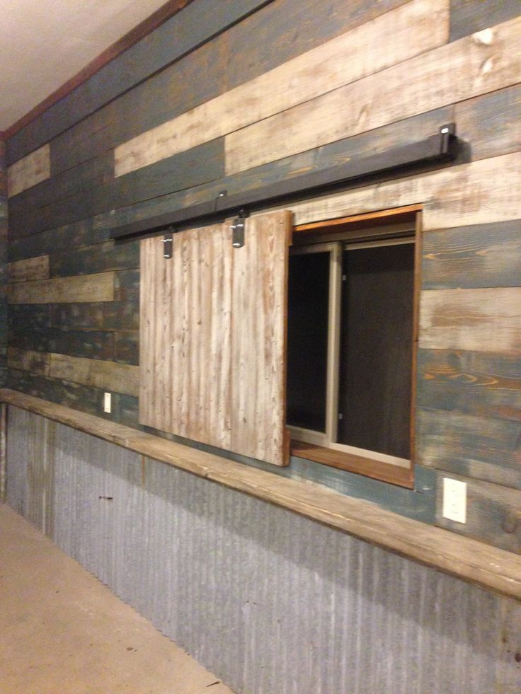 My garage (Man cave). Used reclaimed barn wood and door hardware to create slider to cover the windows. The walls are made from new lumber and distressed (found the idea on here, thanks). The shelf and tin is also reclaimed.