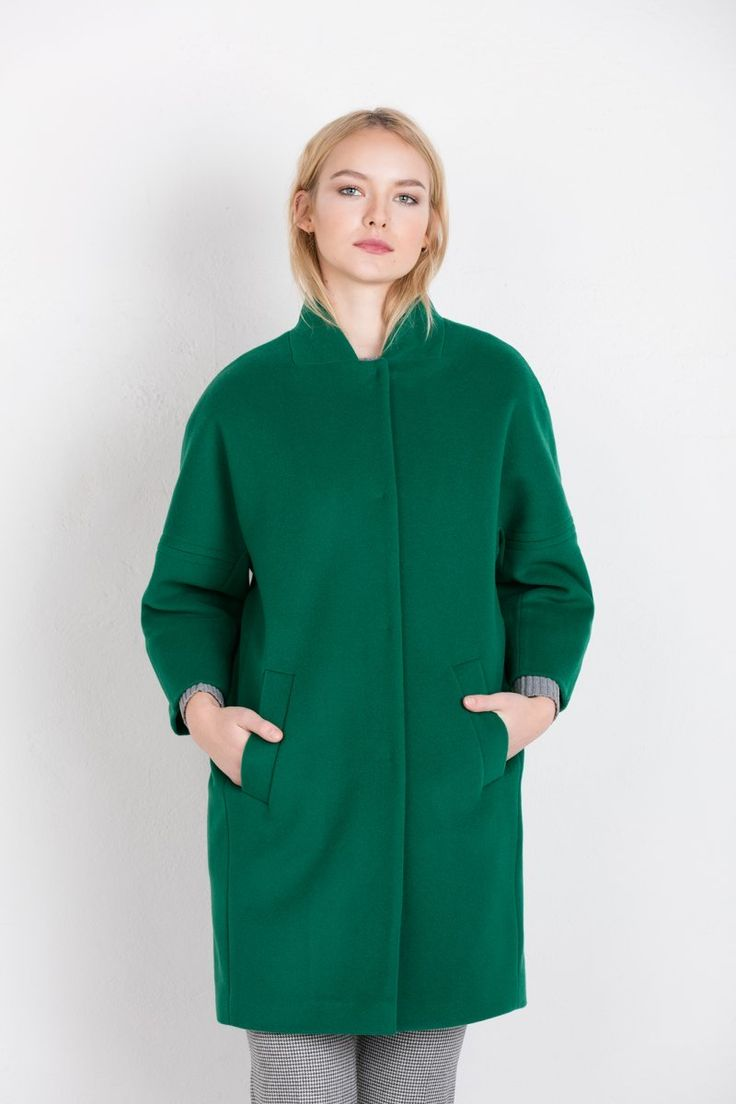 Styling with green wolly coat
