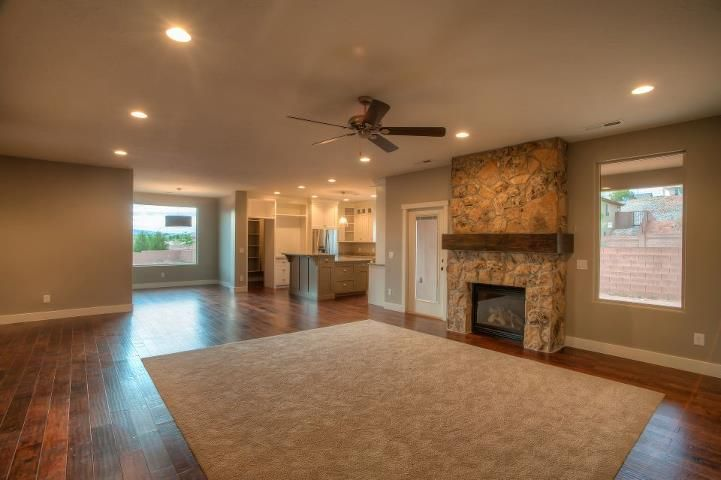 Wood floors with carpet piece i need a bigger house - Hardwood floor living room design ...