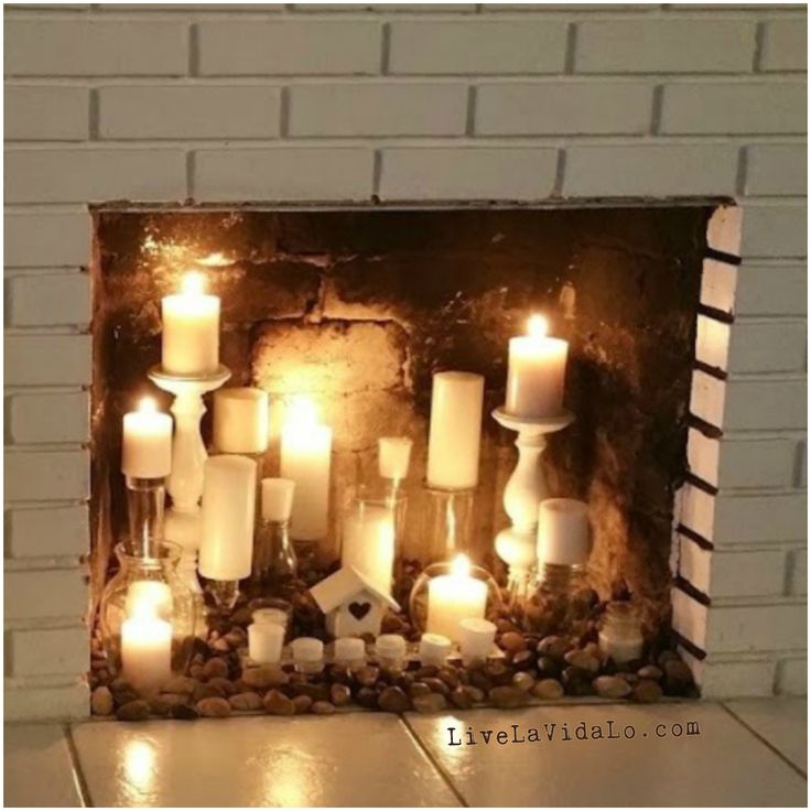 Fireplace with candles and Candles in fireplace