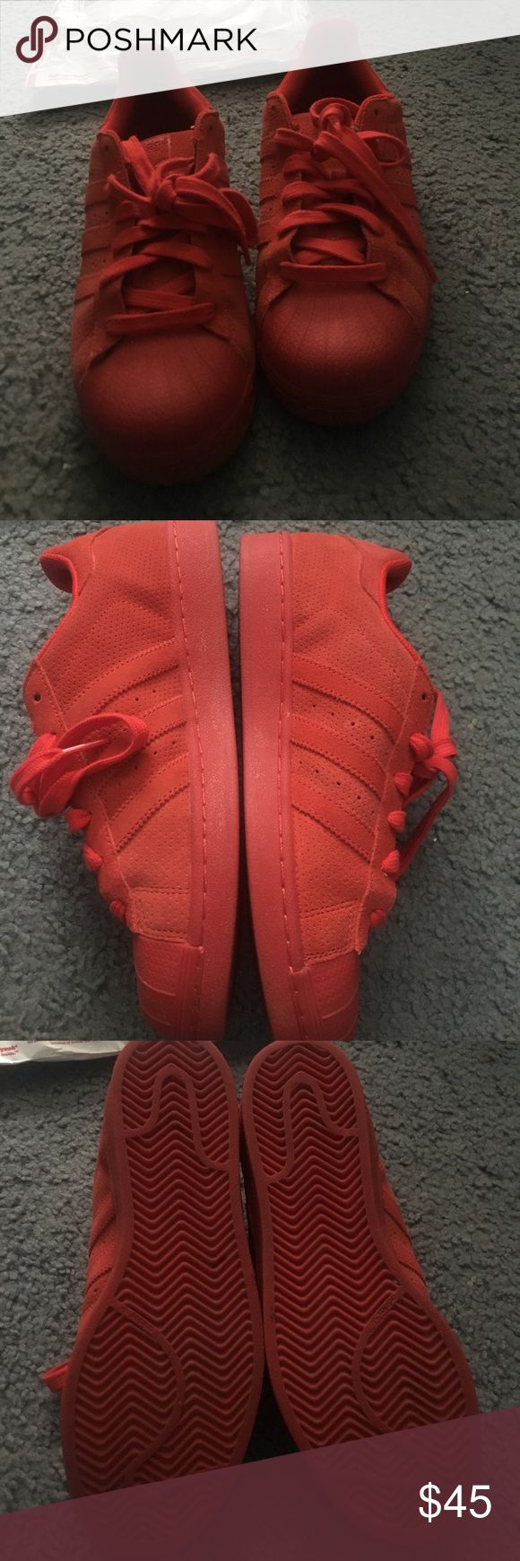 Adidas Red Suede Superstar sneakers men's 7/wmns 9 Can fit a women's 8.5 or 9. Size 7 in men's. 10/10 new condition.A buyer just bought these from me and claimed something was wrong w/ them and then sent them back in the exact condition I sent them in. Please don't buy just to return or I'll block you from the rest of my listings. Material is Suede with red color. Hard to find very unique. Willing to negotiate price, would just like to sell these fast. Make offers!! Shoes Sneakers