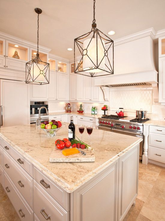 Pretty kitchen ...love the fixtures and red knobs on the stove. Care for some wine and cheese anyone?