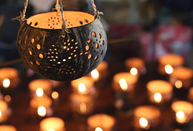 Hand-carved coconut votives light up Chiang Mai's night market. #Thailand