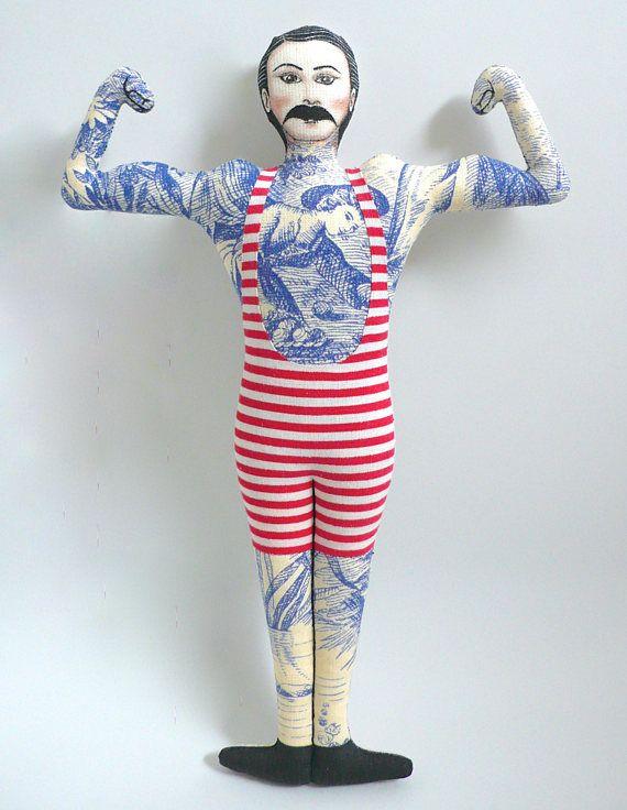 Poupée peinte : Le nageur tatoué moustachu au maillot rouge, page facebook : https://www.facebook.com/clairefabrications/