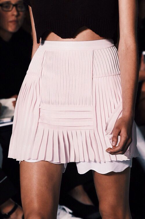 Blush pink chiffon pleated mini skirt.