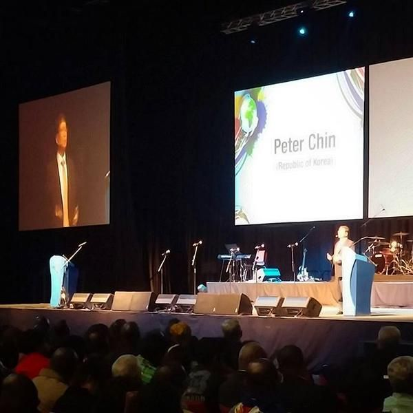 Peter Chin, pastor of Global Mission Church in the Republic of Korea, preaches on light and darkness at opening session of the BWA's 2015 World Congress in Durban. Photo by Brian Kaylor.
