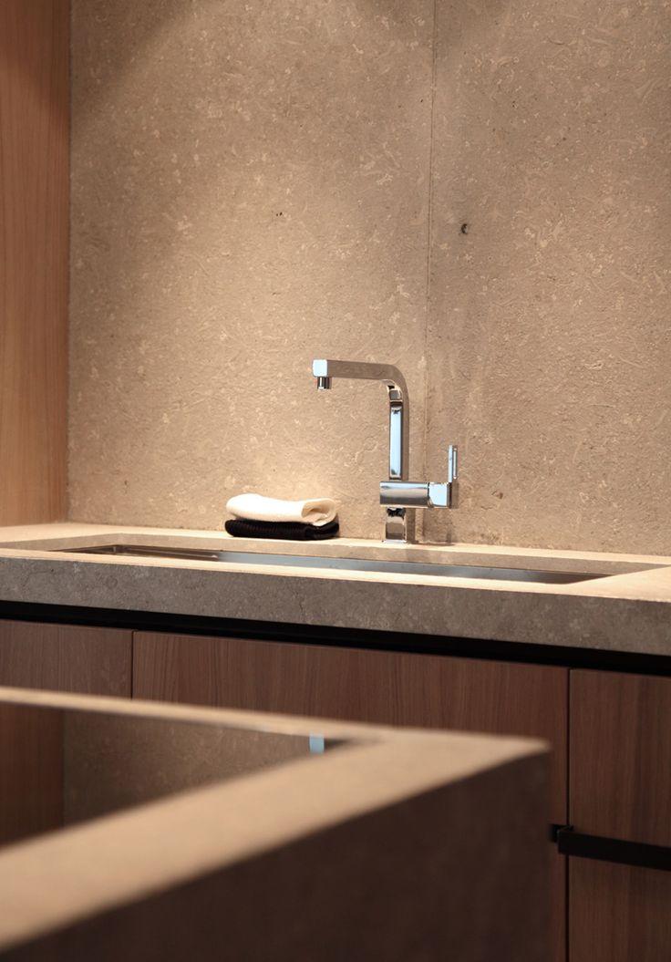 Wood and limestone bathroom by Co.studio.