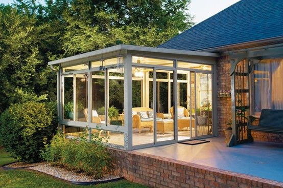 Interesting-decorating-ideas-for-sunroom-with-sunroom-as-a-house-extension-plus-spacious-window-glass-and-wooden-goldie-sofa-view-from-outside1-2