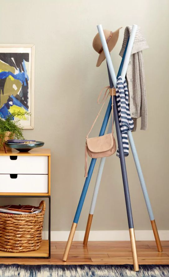 Try making yourself a trendy coat rack instead. This little beauty of a DIY is magazine worthy — I'm not kidding, it was actually featured in Redbook.