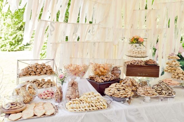 who doesn't love a cookie bar - this couple was on a budget and asked close friends & family to bring their signature cookie; add a takeout box and it doubles as the guests gift