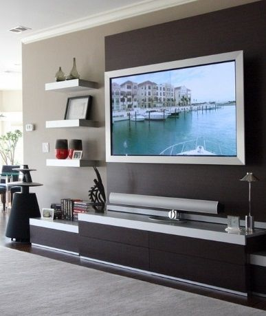 Floating shelves + a modern entertainment center results in a clean, sophisticated television center. Verizon #Techoration Contest Entry