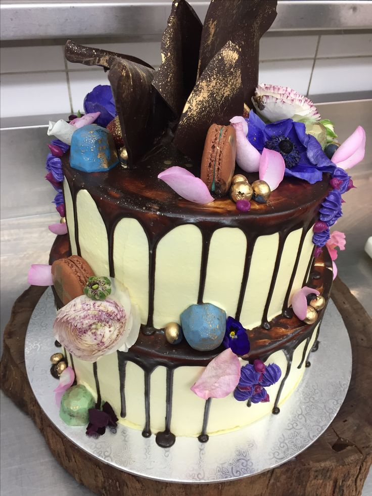 Rich and decadent wedding cake - just how wedding cakes should be #wedding #cake #rose #petals #macaroon #truffles #chocolate