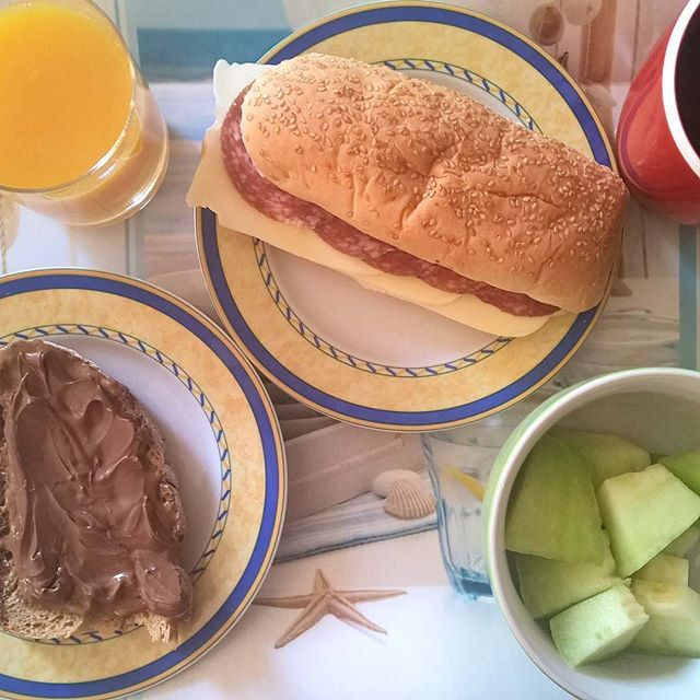 As long as we have Fridays: A tasty sandwich with mozzarella and spicy salami, a slice of sourdough with almond butter and milk chocolate spread and some perfectly chilled melon. #thenewbreakfasteverydayproject #livingmylifemyway